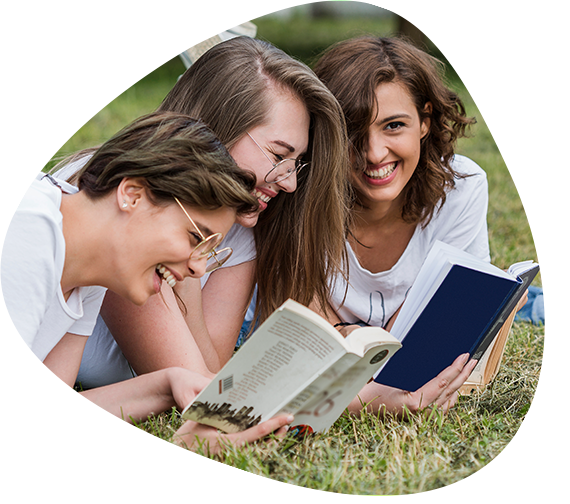 Three Young People Reading Books in Park